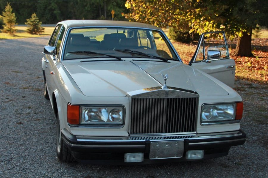 """1989 Rolls Royce Silver Spur car with 100,000 original miles, original """"magnolia"""" paint, supple and pristine leather interior and ice-cold air conditioning (est. CA$12,000-$15,000)."""