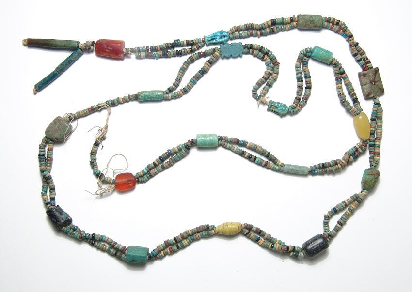 Strand of quality, primarily Egyptian multi-colored faience disk beads, 48 inches long, strung with several Egyptian faience amulets featuring standing deities (est. $500-$700).