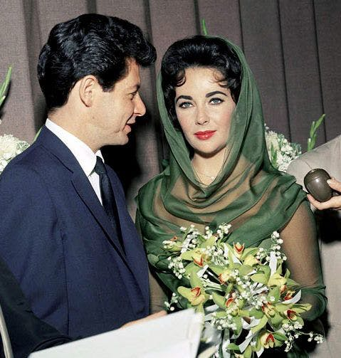 Elizabeth Taylor and Eddie Fisher married on May 12, 1959 in Las Vegas. The bride wore a wedding dress in smoky green. Image: Pinterest