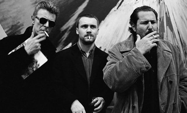 David Bowie with Damien Hirst and Julian Schnabel at a Vanity Fair party in 1996