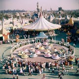 People riding the teacup ride at Disneyland Amusement Park.