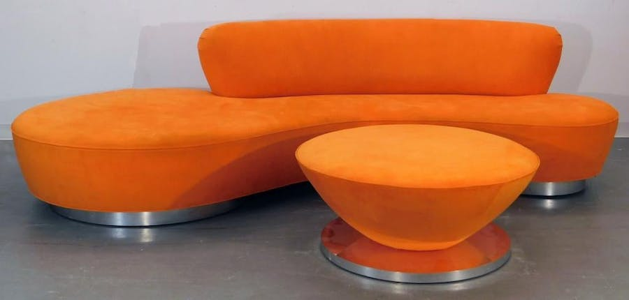 Sofa and ottoman set by Vladimir Kagan (German-American, 1927-2016), with an orange biomorphic serpentine sofa on aluminum feet and a round, tapered ottoman (est. $6,000-$9,000).