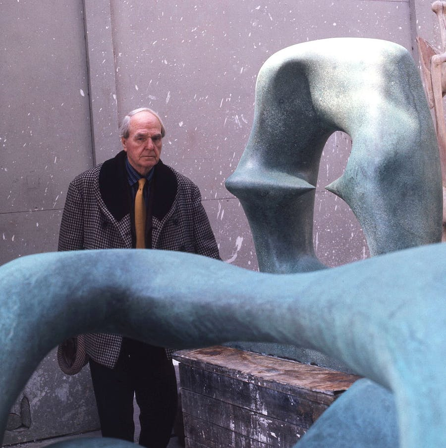 """Moore next to his work """"Working Model for Oval with Points"""". Photo via Wikimedia Commons."""