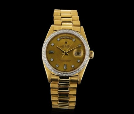 Montre Day-Date Rolex en or blanc 18 carats et diamants