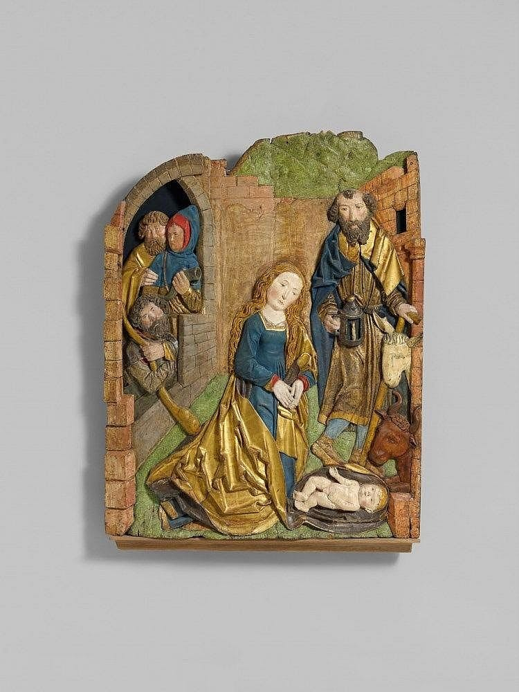 A carved limewood high-relief depiction of the nativity from the workshop of Tilman Riemenschneider