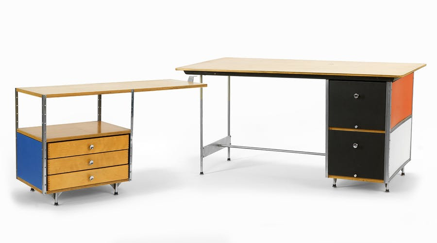 Charles and Ray Eames for Herman Miller desk and return. The birch top desk has multi-color sides; the return is yellow and blue, sided with birch top and three drawers (est. $2,000-$4,000).