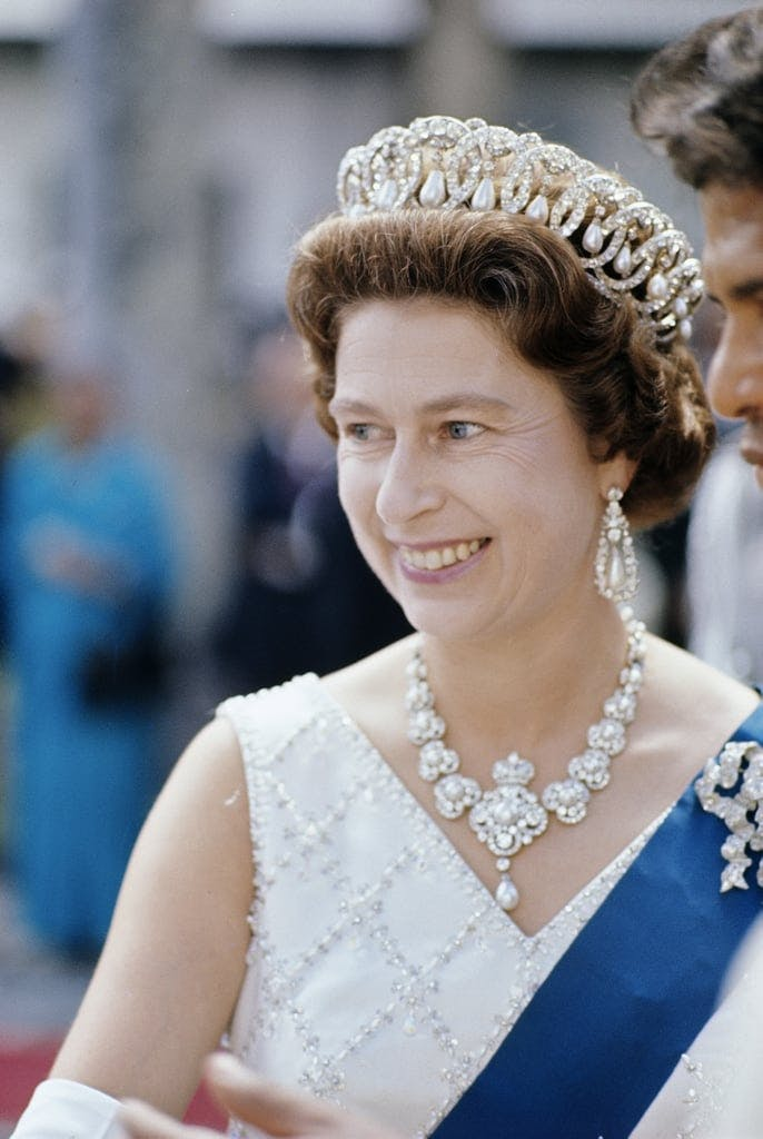 Queen Elizabeth II wearing the Duchess' tiara purchased by Queen Mary, her grandmother. Image: Popsugar