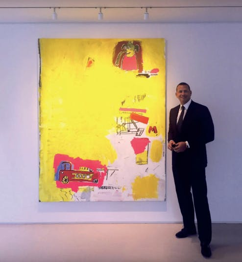 A-Rod in front of Basquiat's Pink Elephant and Cab Engine. Image: Phillips