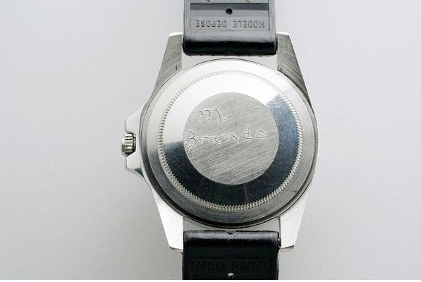 """M. Brando"" engraving on the back of the watch, made by the same actor. Photo: Phillips"