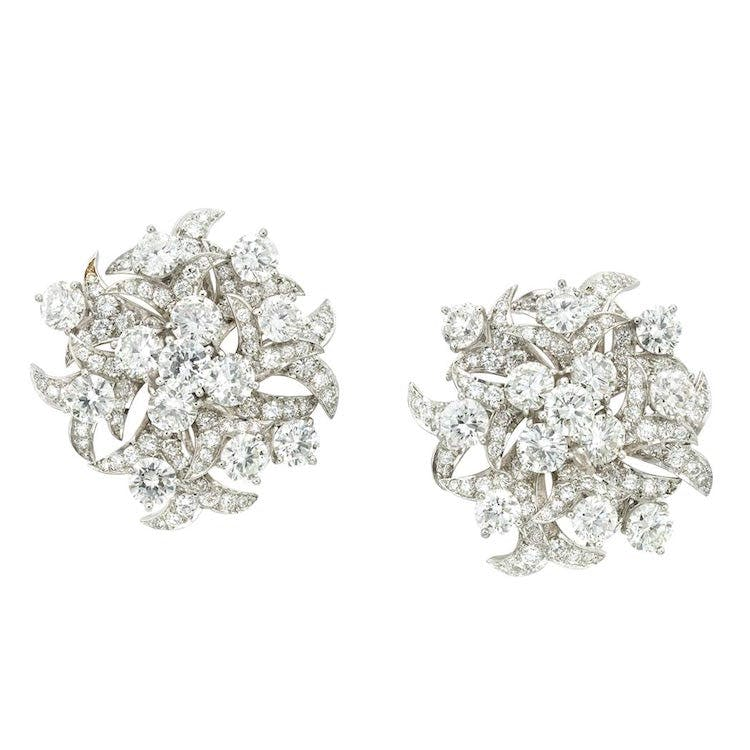 Pair of Platinum and Diamond Earclips, by Donald Claflin for Tiffany & Co. Estimate $20,000-$30,000. Photo via Doyle New York