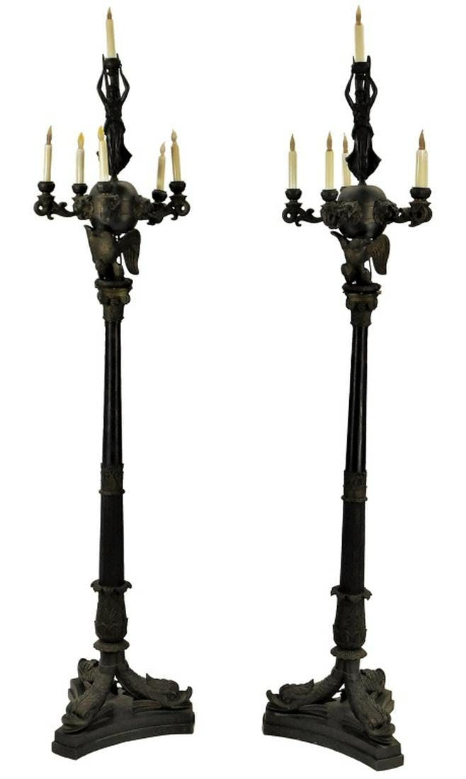 Remarkable pair of 19th century French Empire neoclassical bronze torchieres, each one 84 inches tall each and both fine cast gilt and patinated bronze (est. $12,000-$18,000).