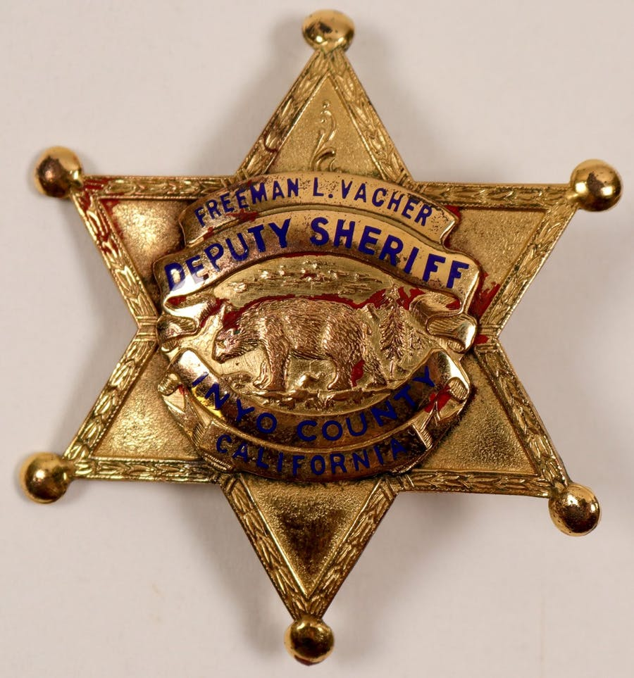 Gold plated six-point sheriff's badge from Inyo County, California (est. $400-$1,000).