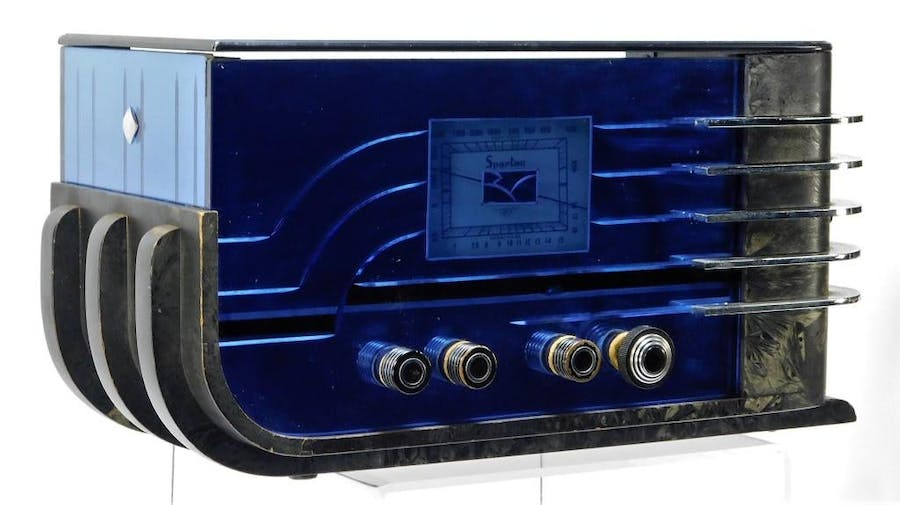 Walter Dornin Teague (American, 1883-1960) for Sparton model 557 sled radio, made in the Art Deco style, with cobalt blue mirrors on the front, top and left side (est. $2,000-$3,000).