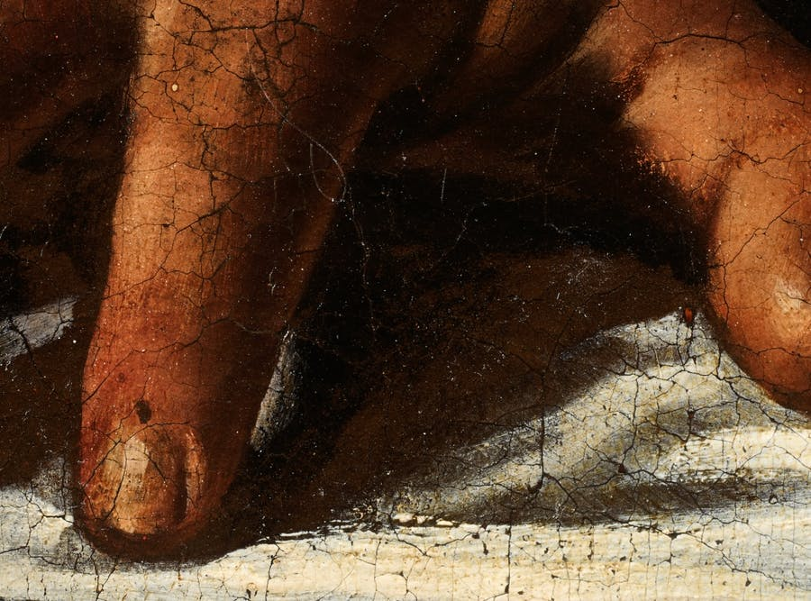 In this detail of Holofernes' hand, the brown paint is left in reserve to mark the shadows, the to the technique 'a risparmio', image © The Toulouse Caravaggio