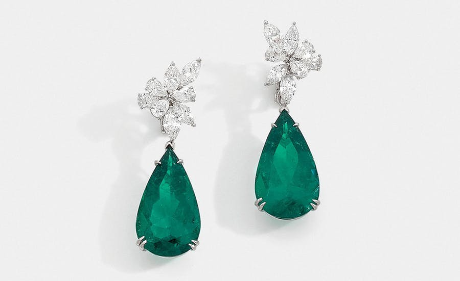 Pendant earrings with diamonds supporting two removable pear emeralds, image © HVMC