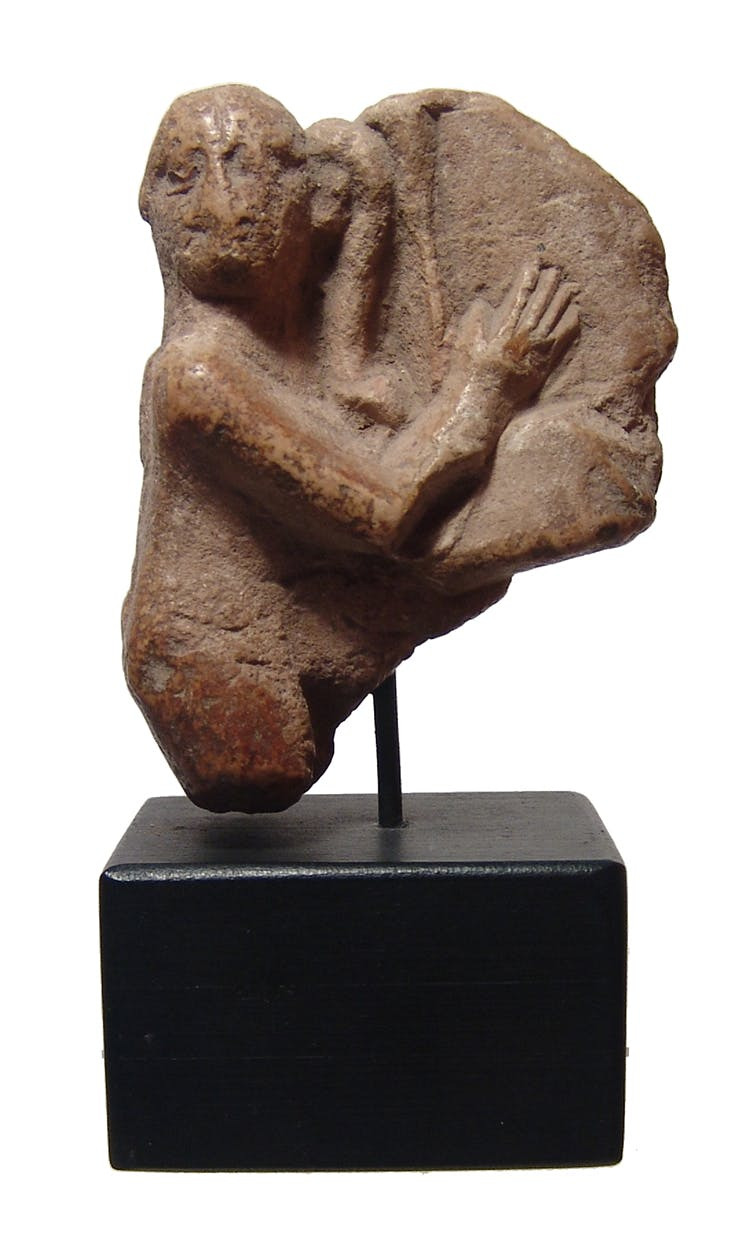 Egyptian limestone ithyphallic Harpokrates (Late Period, circa 705-30 BC), 2 ¾ inches tall and custom mounted. The figure, with mineral deposits, is depicted nude (est. $500-$700).