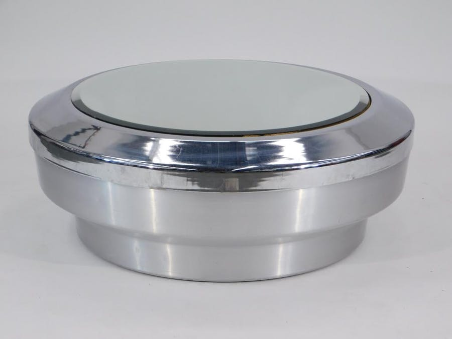 Large and rare Gj Neville canister drum coffee table, made in the United States from steel, wood and glass in the 20th century, cylindrical metal, 40 inches in diameter (est. $2,000-$3,000).