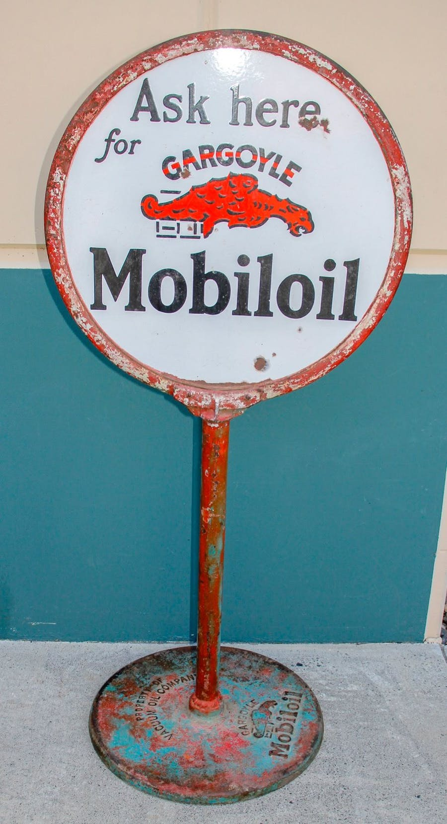 Mobiloil Gargoyle porcelain double-sided lollipop petroliana sign with original heavy lead base, a genuine early 1900s piece in all original condition, overall 54 inches tall (est. $1,700-$2,700).