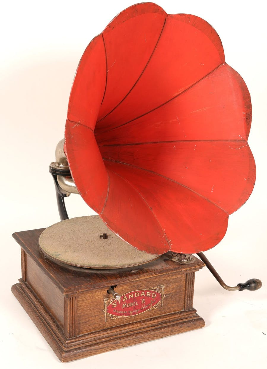 Standard Talking Machine Model A phonograph, untested, circa 1910, crank-operated, with wooden case and metal speaker horn, suitable as a display item (est. $500-$1,000).